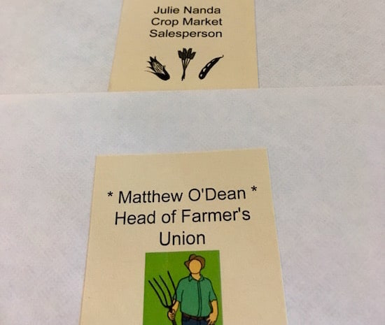 Character envelopes for Mathew O'Dean, head of the farmer's union, and Julie Nanda crop market salesperson.