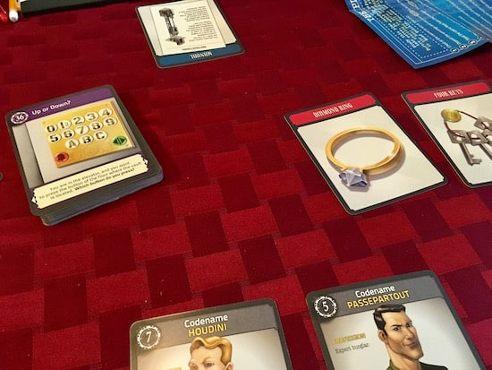 Mid-game, assorted cards are revealed on the table.
