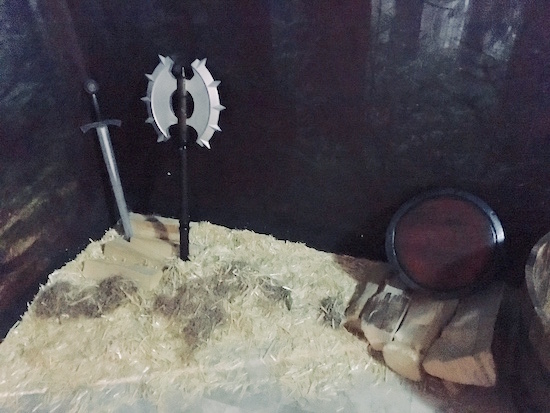 In-game: a sword, axe, shield, and wood.
