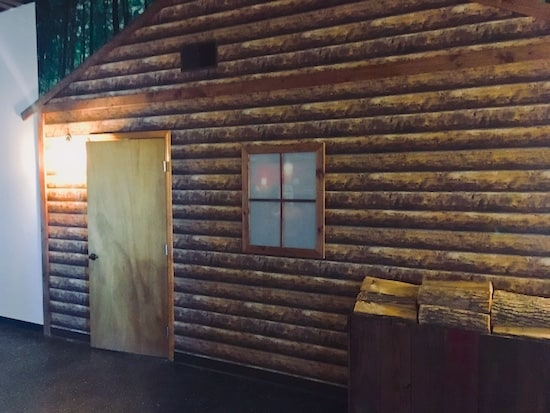 The exterior of Cabin in the Woods. Looks like a log cabin.