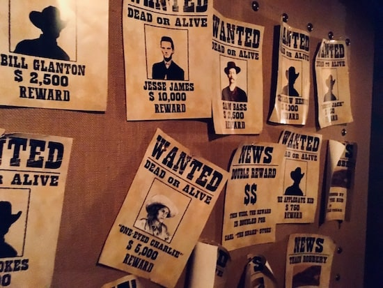In-game: a wall of wanted posters.