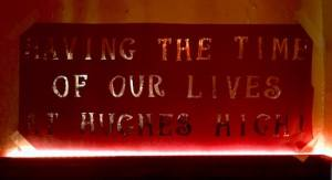 """In-game: Prom banner reads, """"Having the time of our lives at Hughes High!"""""""