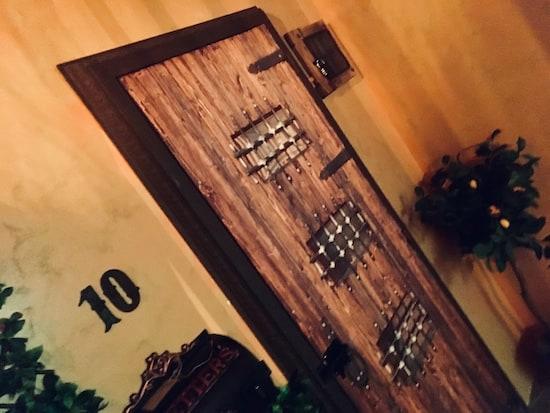 In-game: A hefty wooden door addressed number 10.