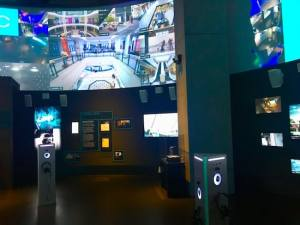 The surveillance exhibit surrounded by security camera feeds.