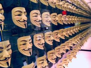 An endless wall of Guy Fawkes masks.