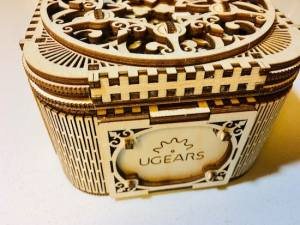 Front of the completed Treasure Box bears the UGears logo.