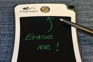 "A small boogie board that reads, ""Erase me!"" and points at the erase button."
