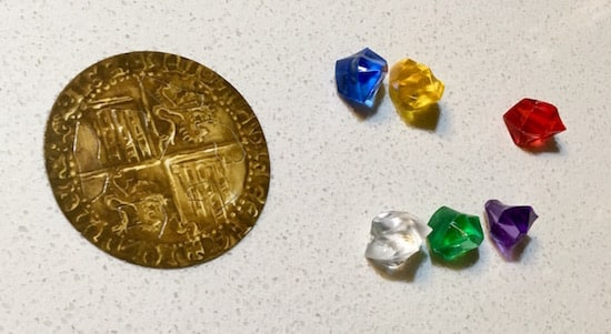 An old gold coin and 6 gems of different colors.