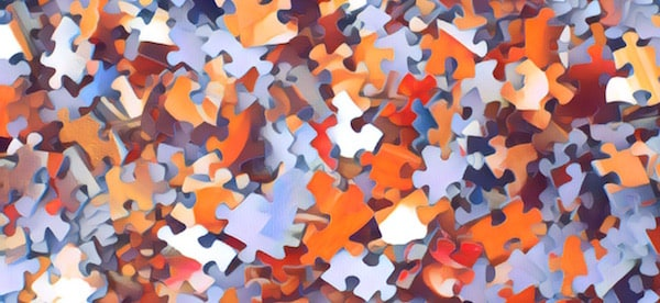 Stylized image of assorted jigsaw puzzle pieces.