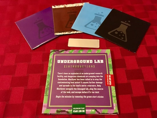 The assorted contents of the chapter 1, Underground Lab includes: 4 smaller colored envelopes, a mirror, and a sticker sealed mission.