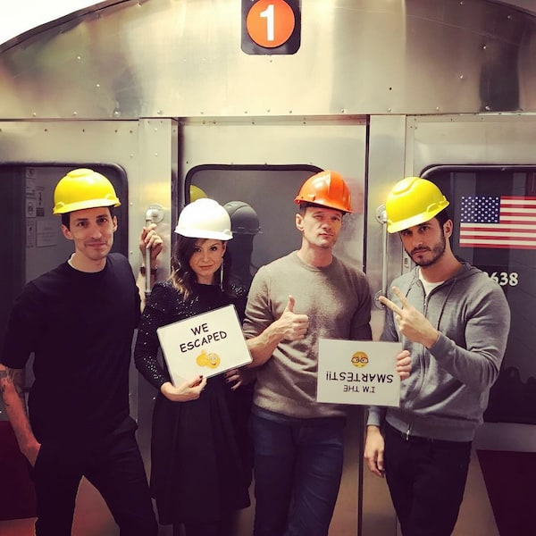 Neil Patrick Harris and team's victorious post-game photo in front of a subway car at High Speed NYC.