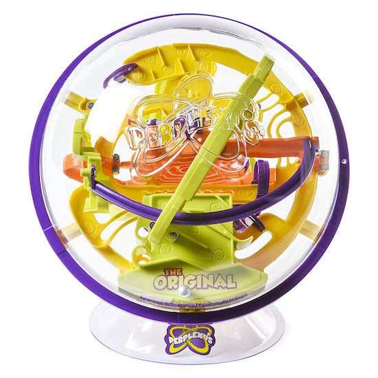 A clear sphere filled with colorful ramps and mazes.