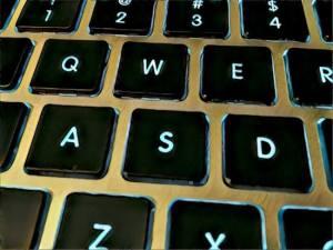 Close up of glowing WASD keys on an keyboard.