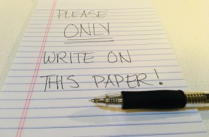 "A notepad that reads, ""Please ONLY write on this paper!"""