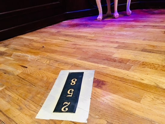 "In-game: The number ""2 5 8"" mounted to the floor."
