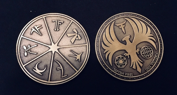In-game: two sides of an ornate 7 Forces coin.