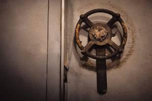 In-game: close-up of a wheel/ door handle.