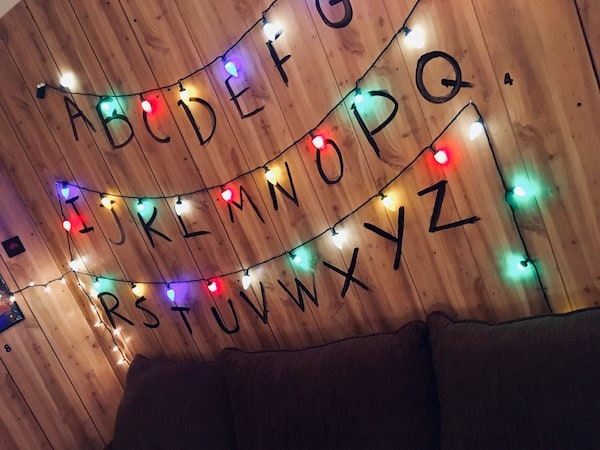 In-game: The letters A-Z painted on the wall, each has a single Christmas light lit above it.