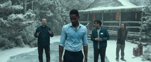 4 characters outside of a cabin in the middle of a snowy forest.