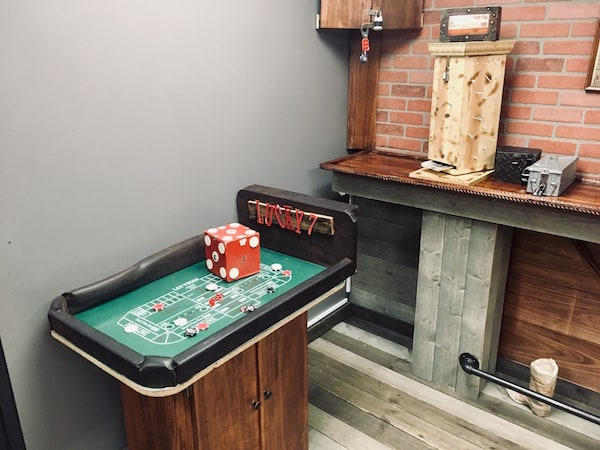 In-game: A small craps table beside a strange wooden construction with nails protruding from it.