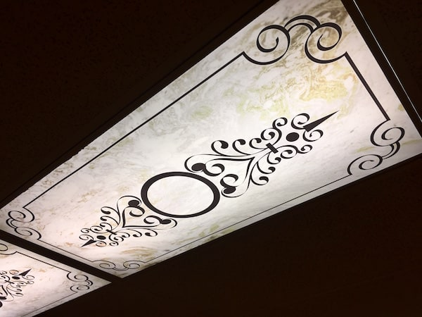 In-game: An ornate covering over the fluorescent light.