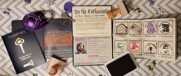 Multiple passports opened to reveal the different pages, all surrounded by stamps, locks, keys, and puzzle pieces.