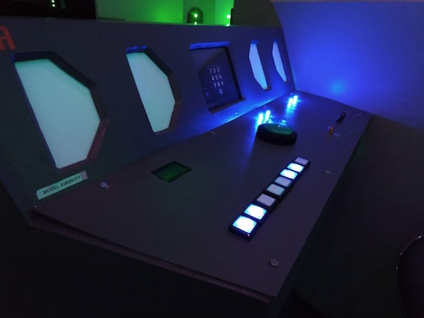 In-game: A space ship control panel with glowing buttons.