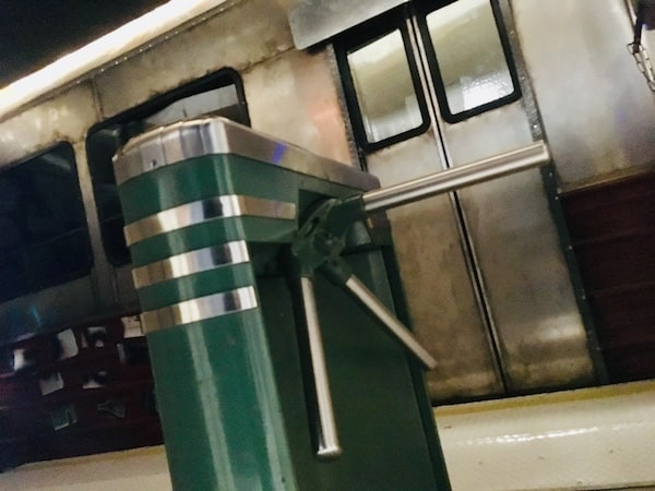 In-game: An authentic turn style before a subway car.