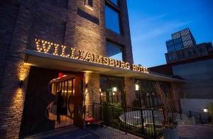 The Williamsburg Hotel lit at night.
