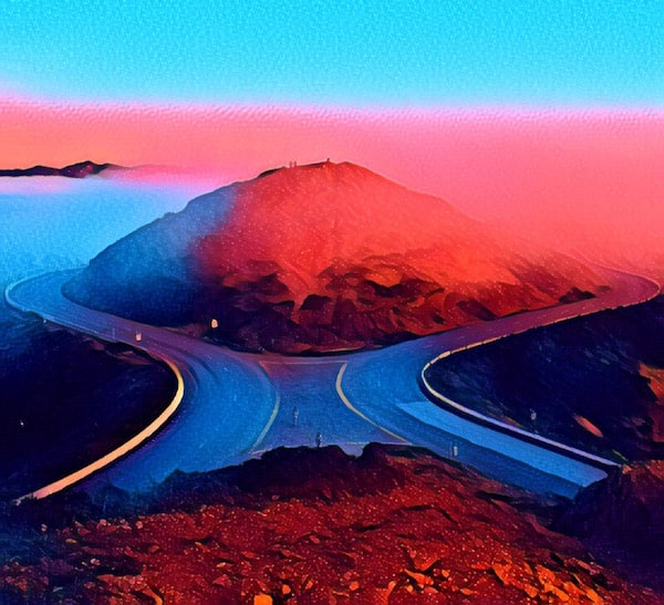 Stylized image of a road splitting around a mountain.