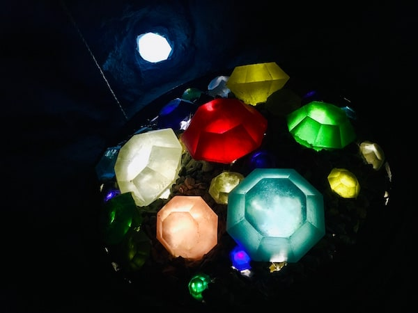 In-game: A collection of gems glowing in the dark.