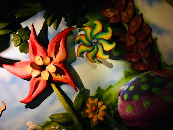 In-game: Brightly colored flowers and mushrooms.