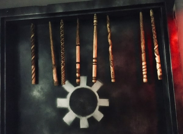 In-game: 8 magic wands hanging from the top of a doorway.