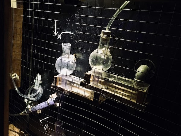 In-game: A series of tubes and lab equipment mounted to the wall.