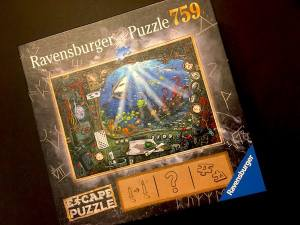 Ravensburger's Submarine Escape Puzzle box art. depicts the 759 piece count and an undersea view filled with fish and a shark.