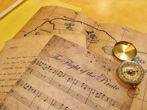 A letter, sheet music, a map, and compass.