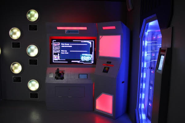 In-game: a glowing sci-fi computer in a spaceship.