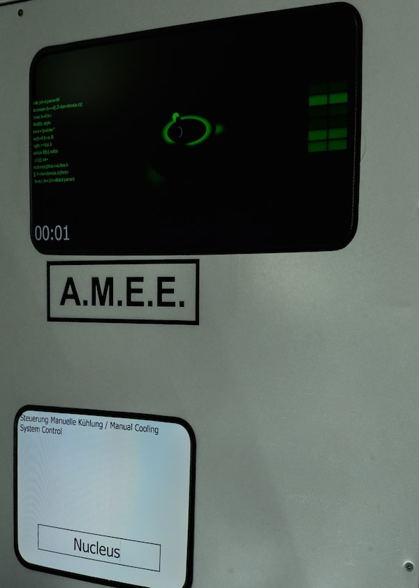 "In-game: A computer console labeled ""A.M.E.E."""