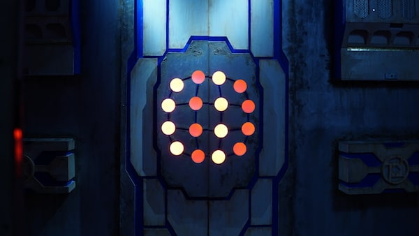In-game: A matrix of glowing dots on a door.