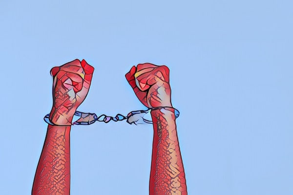 Stylized image of hands raised with handcuffs binding them together.