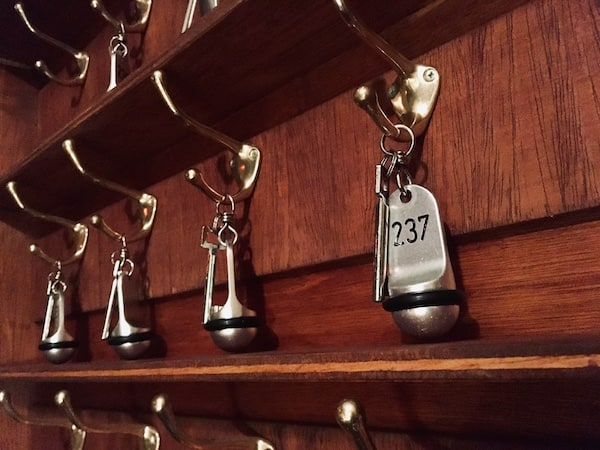 In-game: Close up the the hotel's key storage. The key for room 237 clearly the focus of the image.