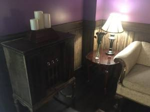 In-game: A large antique radio beside a couch.