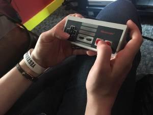 Lisa's hands on an NES controller.