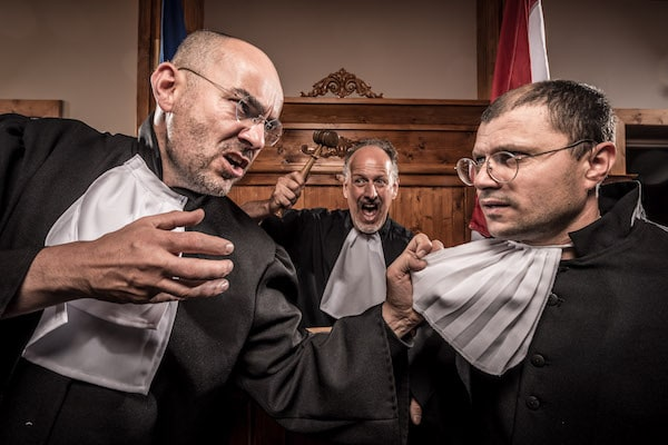 A gleeful judge watching two lawyers physically grabbing one another with anger in their eyes.