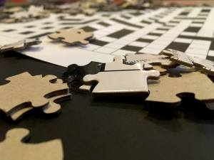 Closeup of loose jigsaw puzzle pieces.