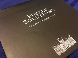 """An envelope labeled """"Puzzle Solutions for emergencies only"""""""