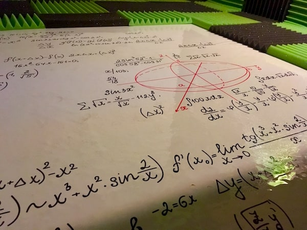 In-game: a whiteboard covered in equations.