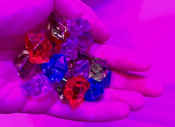 In-game: a handful of multicolored gems.