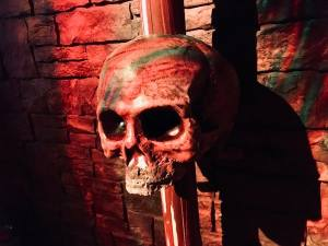 In-game: A human skull on a spike in a tomb.