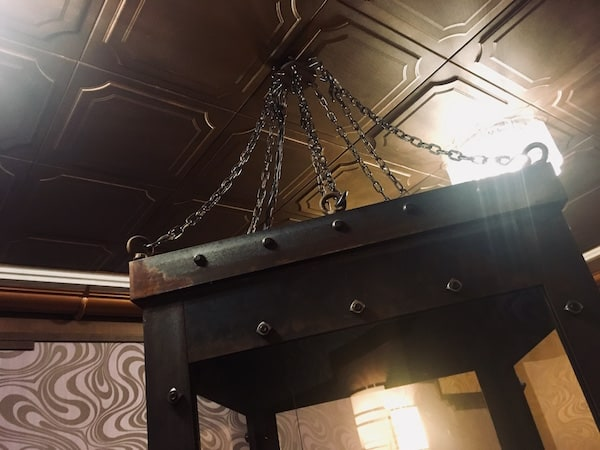 In-game: A water torture chamber hanging from the ceiling.